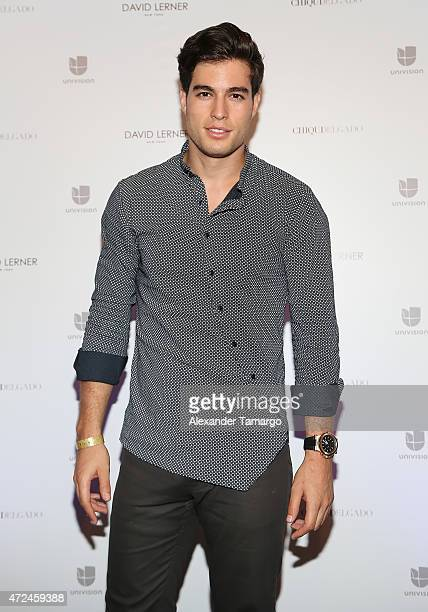 Danilo Carrera poses at Studio LX during the clothing launch of Chiquinquira Delgado in collaboration with David Lerner on May 7 2015 in Miami Florida