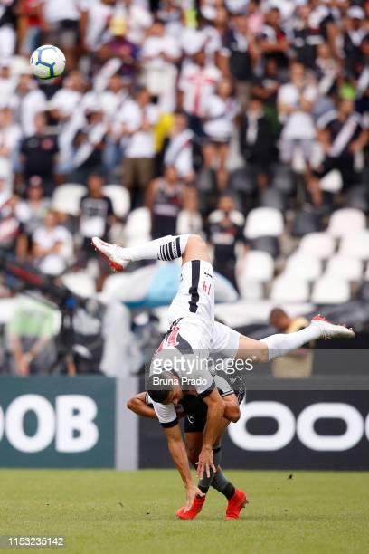 Danilo Carvalho of Vasco da Gama competes for the ball with Erik of Botafogo during a match between Botafogo and Vasco da Gama as part of the...