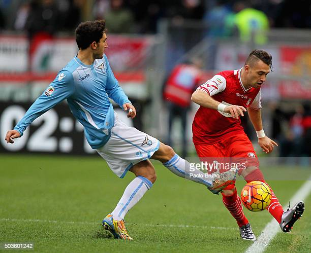 Danilo Cataldi of SS Lazio competes for the ball with Gaetano Letizia of Carpi FC during the Serie A match between SS Lazio and Carpi FC at Stadio...