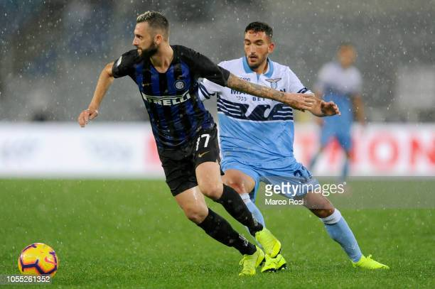 Danilo Cataldi of SS Lazio competes for the ball with Marcelo Brozovic of FC Internazionale during the Serie A match between SS Lazio and FC...