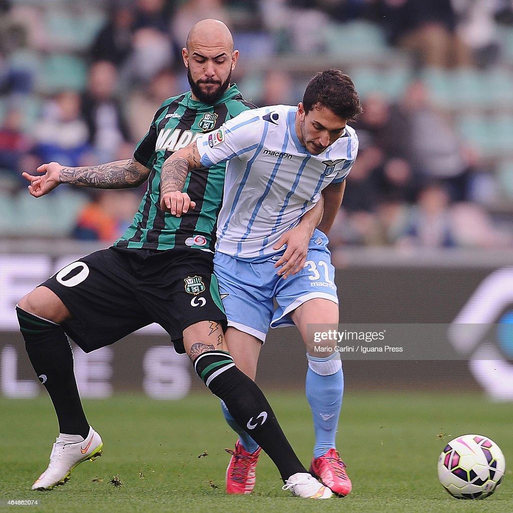 Danilo Cataldi # 32 of SS Lazio ( R ) competes ther ball with Simone Zaza # 109 of US Sassuolo Calcio ( L ) during the Serie A match between US Sassuolo Calcio and SS Lazio on March 1, 2015 in Reggio nell'Emilia, Italy.