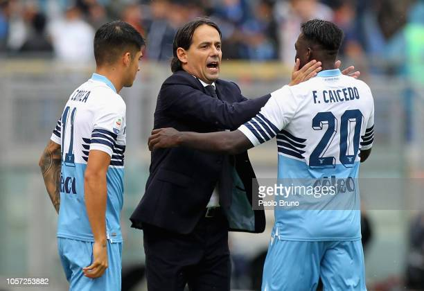 Danilo Cataldi with his head coach Simone Inzaghi of SS Lazio celebrates after scoring the team's third goal during the Serie A match between SS...