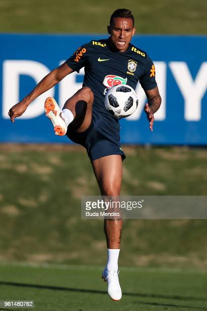 Danilo controls the ball during a training session of the Brazilian national football team at the squad's Granja Comary training complex on May 22...