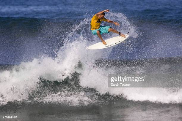 Danilo Costa of Brazil surfs during the Round of 128 surfs in the Vans Triple Crown of Surfing Reef Hawaiian Pro at Haleiwa Alii Beach Park November...