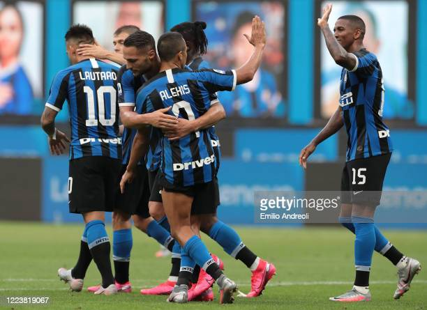 Danilo D Ambrosio of FC Internazionale celebrates his goal with his team-mate Alexis Sanchez and Ashley Young during the Serie A match between FC...