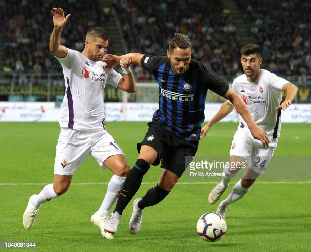 Danilo D Ambrosio of FC Internazionale is challenged by Kevin Mirallas of ACF Fiorentina during the Serie A match between FC Internazionale and ACF...
