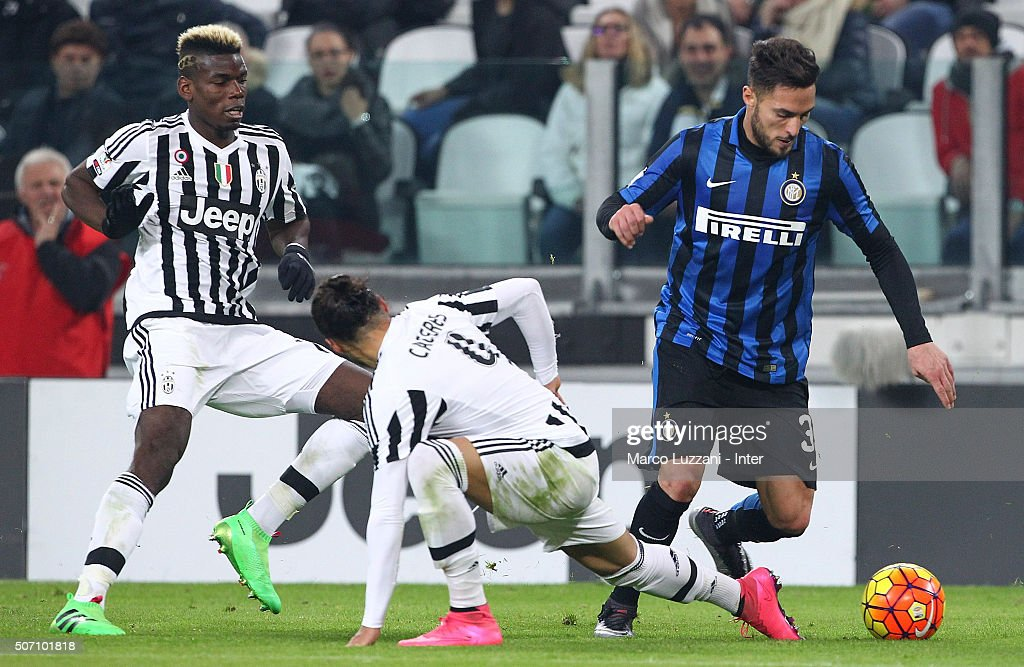 Danilo D Ambrosio (R) of FC Internazionale Milano is challenged by Martin Caceres (C) of Juventus FC during the TIM Cup match between Juventus FC and FC Internazionale Milano at Juventus Arena on January 27, 2016 in Turin, Italy.
