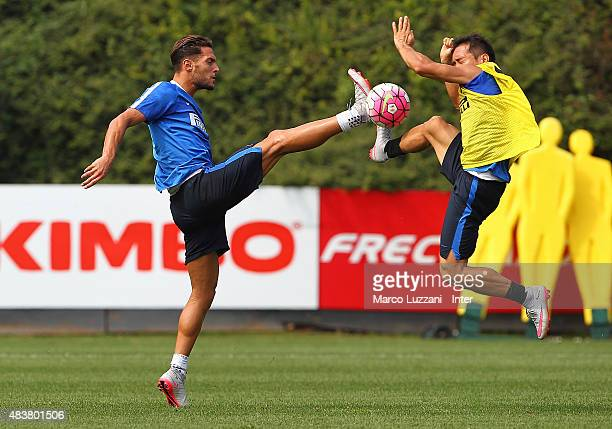 Danilo D Amombrosio competes with Yuto Nagatomo during FC Internazionale training session at the club's training ground on August 13 2015 in Appiano...