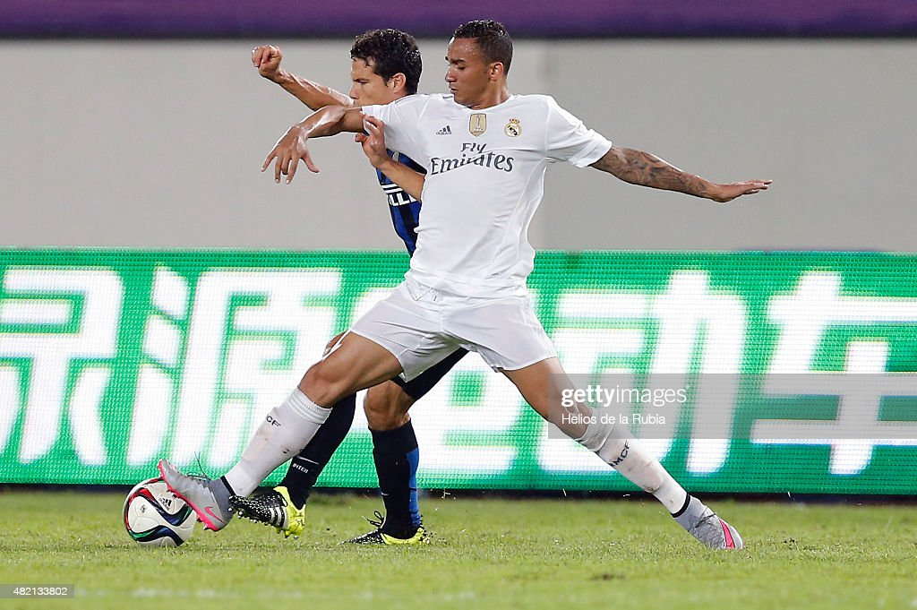 Danilo Da Silva of Real Madrid C.F and Demova of Inter de Milan compete for the ball during the international Champions Cup China match between Real Madrid and Inter de Milan at the Tianhe Stadium on July 27, 2015 in Guangzhou, China.