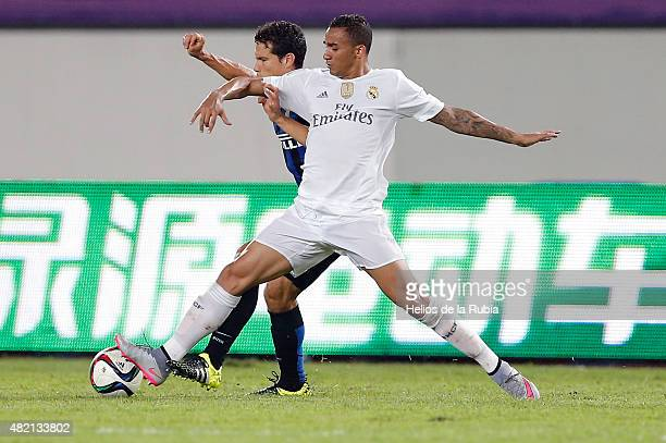 Danilo Da Silva of Real Madrid CF and Demova of Inter de Milan compete for the ball during the international Champions Cup China match between Real...