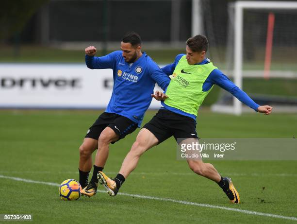Danilo D'Ambrosio and Andrea Pinamonti of FC Internazionale compete for the ball during the FC Internazionale training session at Suning Training...