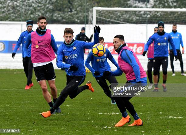 Danilo D'Ambrosio and Andrea Pinamonti of FC Internazionale compete for the ball during the FC Internazionale training session at the club's training...