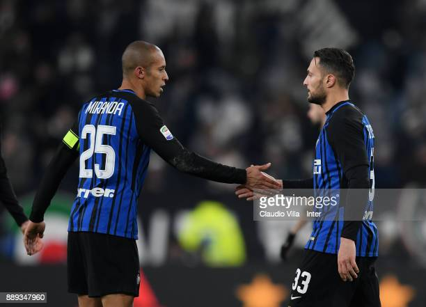 Danilo D'Ambrosio and Joao Miranda de Souza Filho of FC Internazionale celebrate at the end of the Serie A match between Juventus and FC...