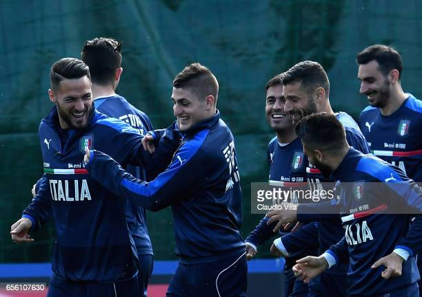 Danilo D'Ambrosio and Marco Verratti of Italy react during the training session at the club's training ground at Coverciano on March 21 2017 in...