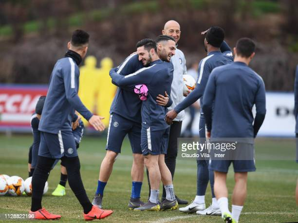 Danilo D'Ambrosio and Matteo Politano of FC Internazionale embrace each other during a FC Internazionale training session at the club's training...