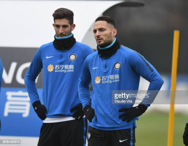 Danilo D'Ambrosio and Roberto Gagliardini of FC Internazionale look on during the FC Internazionale training session at the club's training ground...