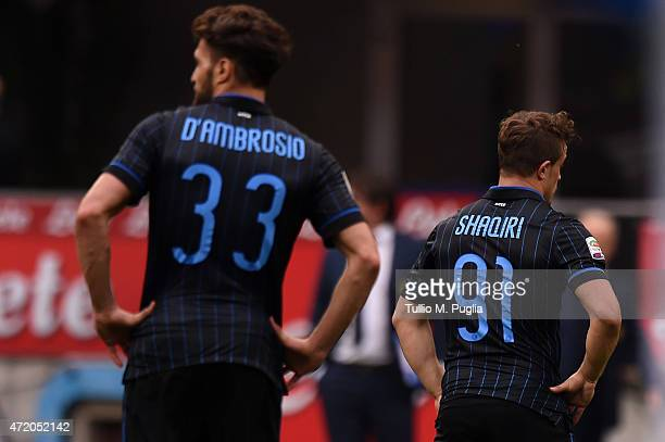 Danilo D'Ambrosio and Xherdan Shaqiri of Internazionale Milano show their dejection after the Serie A match between FC Internazionale Milano and AC...