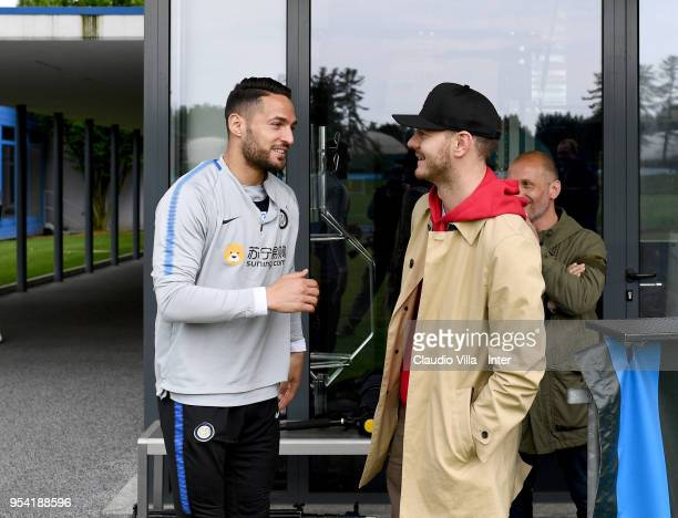 Danilo D'Ambrosio of FC Internazionale and Alessandro Cattelan pose for a photo during the FC Internazionale training session at the club's training...