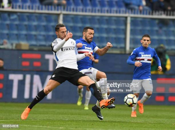Danilo D'Ambrosio of FC Internazionale and Fabio Quagliarella of UC Sampdoria compete for the ball during the serie A match between UC Sampdoria and...