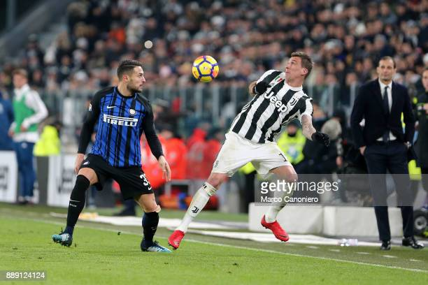 Danilo D'Ambrosio of FC Internazionale and Mario Mandzukic of Juventus Fc in action during the Serie A match between Juventus Fc and Fc...
