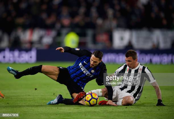 Danilo D'Ambrosio of FC Internazionale and Mario Mandzukic of Juventus FC compete for the ball during the Serie A match between Juventus and FC...