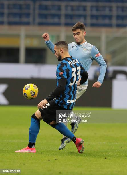 Danilo D'Ambrosio of FC Internazionale battles for possession with Andreas Pereira of SS Lazio during the Serie A match between FC Internazionale and...