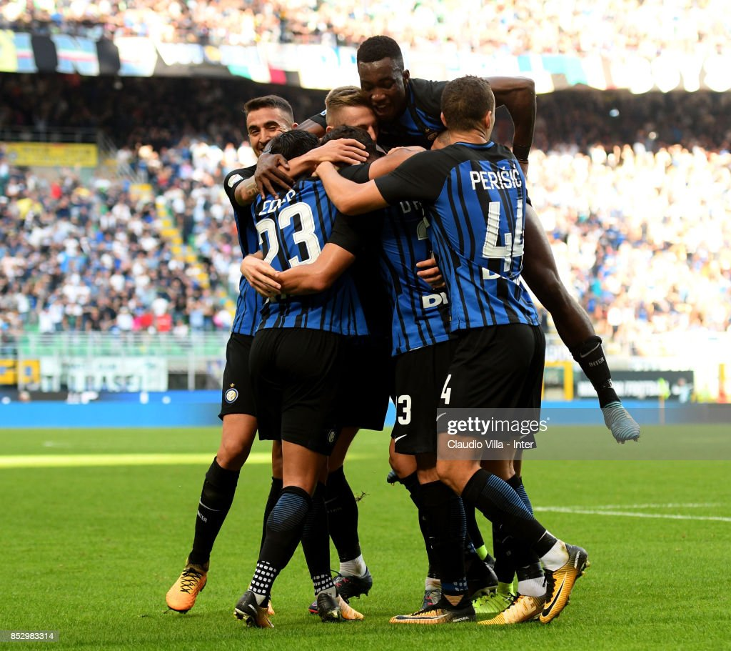 Danilo D'Ambrosio of FC Internazionale (C) celebrates after scoring the opening goal during the Serie A match between FC Internazionale and Genoa CFC at Stadio Giuseppe Meazza on September 24, 2017 in Milan, Italy.