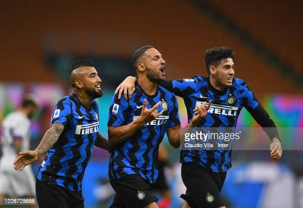 Danilo D'Ambrosio of FC Internazionale celebrates with Arturo Vidal and Alessandro Bastoni after scoring a goal during the Serie A match between FC...
