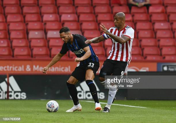 Danilo D'Ambrosio of FC Internazionale competes for the ball against Leon Clarke of Sheffield United during the preseason friendly match between...