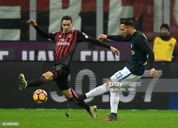 Danilo D'Ambrosio of FC Internazionale competes for the ball Mattia De Sciglio of AC Milan during the Serie A match between AC Milan and FC...