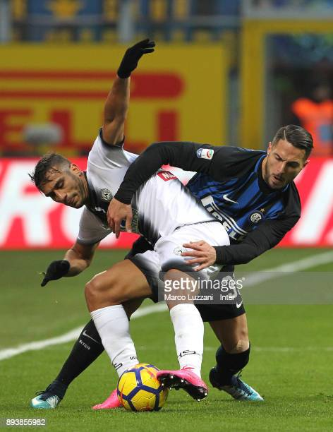 Danilo D'Ambrosio of FC Internazionale competes for the ball with Ali Adnan of Udinese Calcio during the Serie A match between FC Internazionale and...