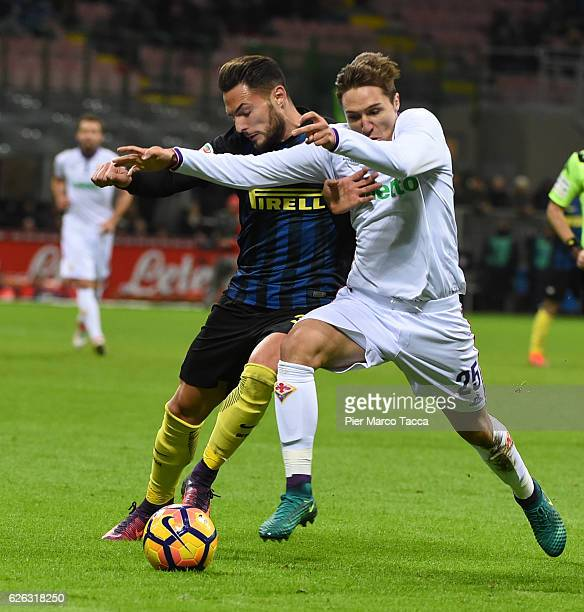 Danilo D'Ambrosio of FC Internazionale competes for the ball with Federico Chiesa of ACF Fiorentina during the Serie A match between FC...