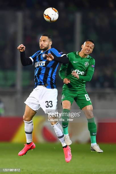 Danilo D'Ambrosio of FC Internazionale heads the ball against Marcelinho of PFC Ludogorets Razgrad during the UEFA Europa League round of 32 first...