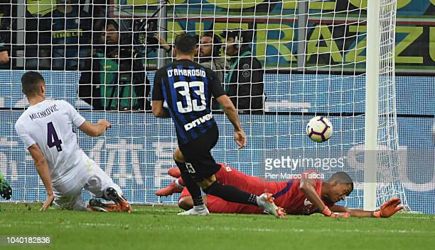 Danilo D'Ambrosio of FC Internazionale pulls the ball into the goal during the serie A match between FC Internazionale and ACF Fiorentina at Stadio...