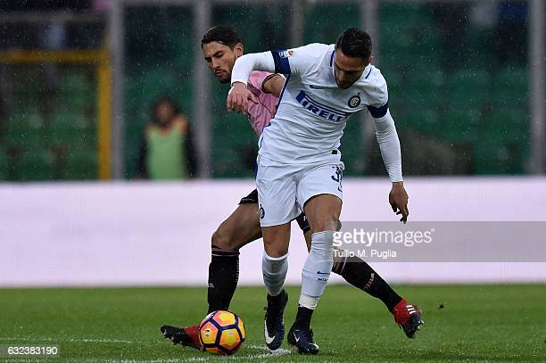 Danilo D'Ambrosio of Inter is challenged by Edoardo Goldaniga of Palermo during the Serie A match between US Citta di Palermo and FC Internazionale...