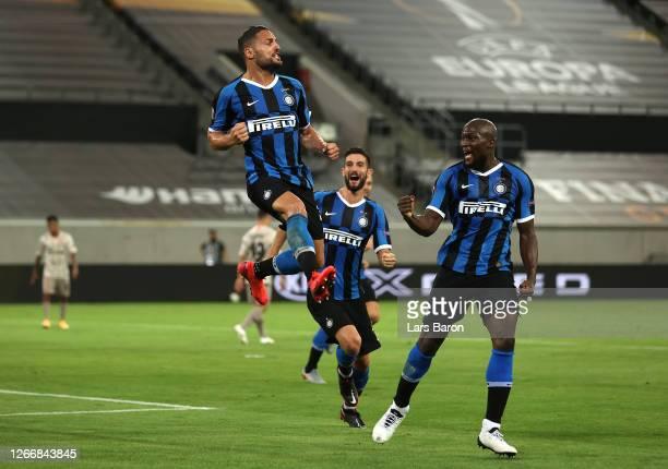 Danilo D'Ambrosio of Inter Milan celebrates with Romelu Lukaku after scoring his team's second goal during the UEFA Europa League Semi Final between...