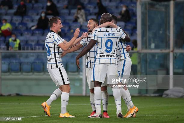 Danilo D'Ambrosio of Internazionale celebrates with team mates after scoring to give the side a 2-0 lead during the Serie A match between Genoa CFC...