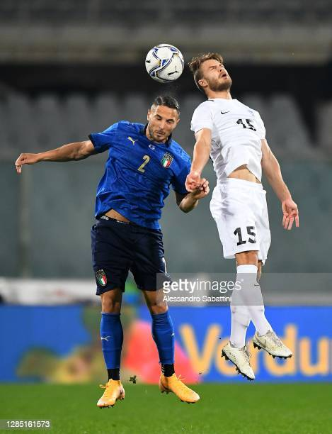 Danilo D'Ambrosio of Italy competes for the ball with Rauno Sappien of Estonia during the international friendly match between Italy and Estonia at...