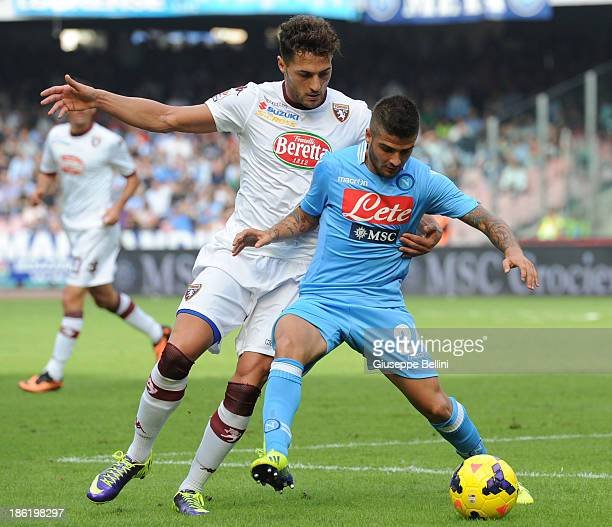 Danilo D'Ambrosio of Torino challenges Lorenzo Insigne of Napoli during the Serie A match between SSC Napoli and Torino FC at Stadio San Paolo on...