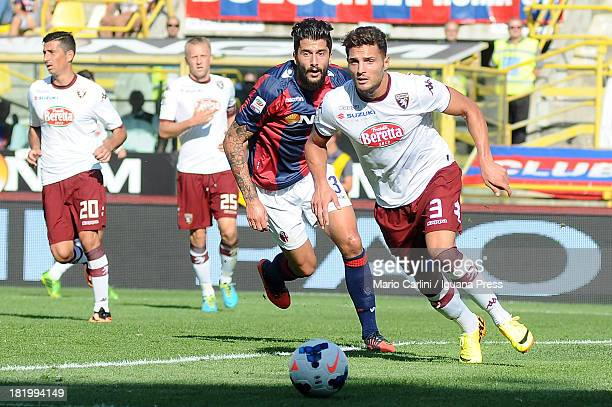 Danilo D'Ambrosio of Torino FC competes the ball with Panagiotis Kone of Bologna FC during the Serie A match between Bologna FC and Torino FC at...
