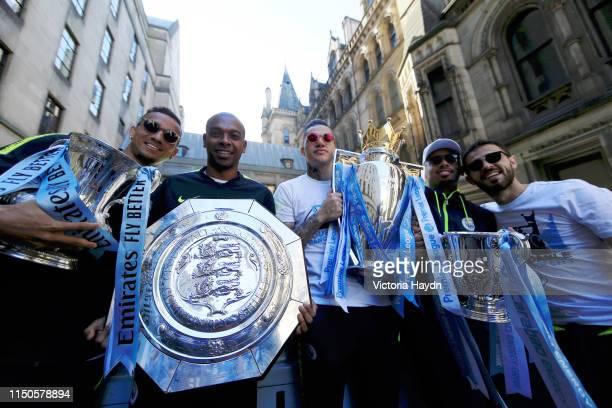 Danilo, Fernandinho, Ederson, Gabriel Jesus and Bernardo Silva of Manchester City celebrate with the The Emirates FA Cup, the FA Community Shield,...