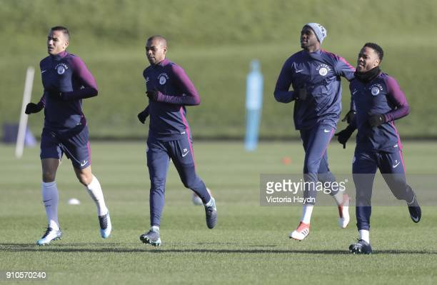 Danilo Fernandinho Eliaquim Mangala and Raheem Sterling in action during training at Manchester City Football Academy on January 26 2018 in...