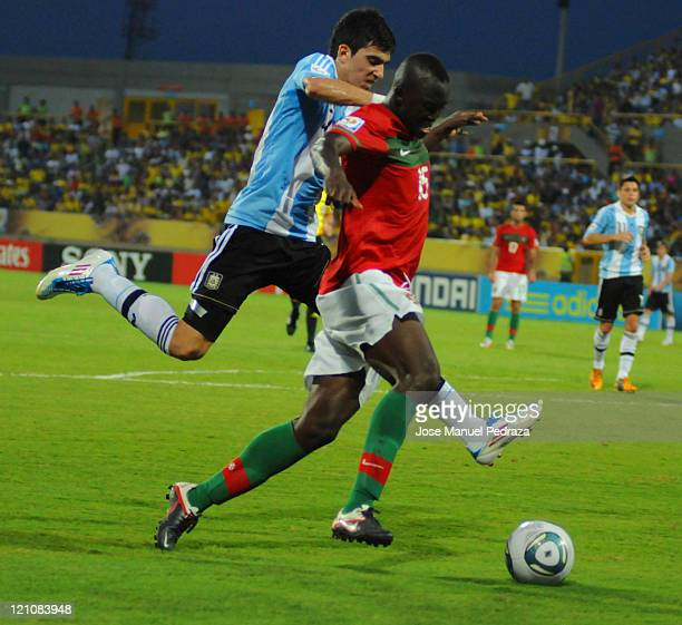 Danilo form Portugal fighst for the ball with Rodrigo Battaglia from Argentina during the match between Argentina and Portugal as part of the U20...