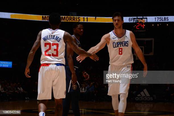 Danilo Gallinari and Lou Williams of the LA Clippers highfive during a game against the Denver Nuggets on January 10 2019 at the Pepsi Center in...