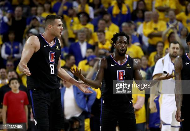 Danilo Gallinari and Patrick Beverley of the LA Clippers question a call during their game against the Golden State Warriors during Game One of the...