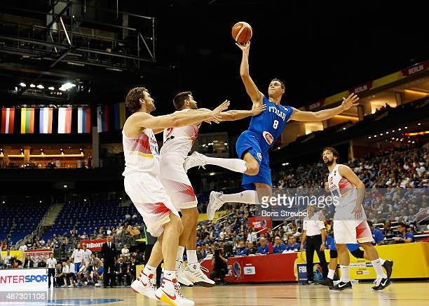 Danilo Gallinari of Italy drives to the basket against Pau Gasol and Felipe Reyes of Spain during the FIBA EuroBasket 2015 Group B basketball match...