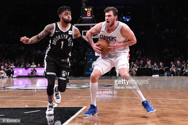 Danilo Gallinari of the LA Clippers drives to the basket against D'Angelo Russell of the Brooklyn Nets during the game at Barclays Center on February...