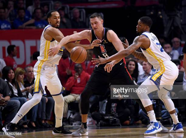 Danilo Gallinari of the LA Clippers loses the ball as he is fouled by Shaun Livingston of the Golden State Warriors with helps from Alfonzo McKinnie...