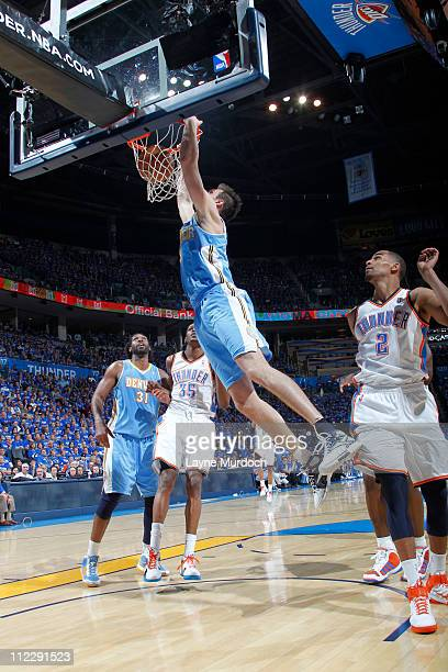 Danilo Gallinari of the Denver Nuggets dunks against Kevin Durant of the Oklahoma City Thunder on April 17 2011 in Game One of the Western Conference...