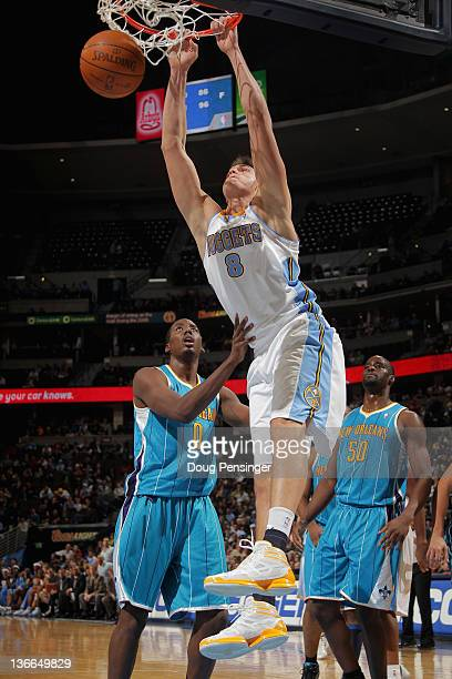 Danilo Gallinari of the Denver Nuggets dunks over Al-Farouq Aminu of the New Orleans Hornets at the Pepsi Center on January 9, 2012 in Denver,...